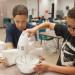 Students in Teens 'n'Tweenslearn how to make cinnamon rolls.