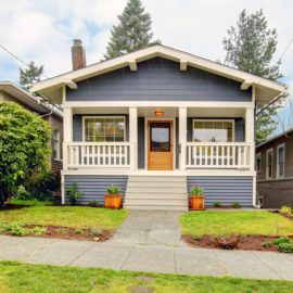 12760946 - small simple blue grey craftsman style house with white porch.